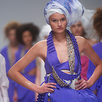 Models exhibit the Jena Theo spring 2011 collection down the catwalk at Somerset House in London on 17 September 2010.