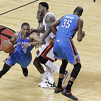 21 June 2012: Oklahoma City Thunder point guard Russell Westbrook (0) drives past Miami Heat point guard Norris Cole (30) and Miami Heat power forward Udonis Haslem (40) on a screen set by Oklahoma City Thunder small forward Kevin Durant (35) during the Miami Heat 121-106 victory over the Oklahoma City Thunder, in Game 5 of the 2012 NBA Finals, at the AmericanAirlinesArena, Miami, Florida, USA. The Miami Heat wins the series 4-1.