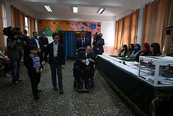 May 4, 2017 - Algiers, Algeria - Algerian President Abdelaziz Bouteflika is seen on a wheelchair as he casts his vote at a polling station in Algiers on May 4, 2017 during parliamentary elections. Algerians voted for a new parliament amid soaring unemployment and a deep financial crisis caused by a collapse in oil revenues. (Credit Image: © Billal Bensalem/NurPhoto via ZUMA Press)
