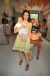 LAUREN KEMP and her son KIT at the 10th anniversary party of the store Caramel, Ledbury Road, London W11.  The party was held in association with the Naked Heart Foundation - a charity set up by model Natalia Vodianova.