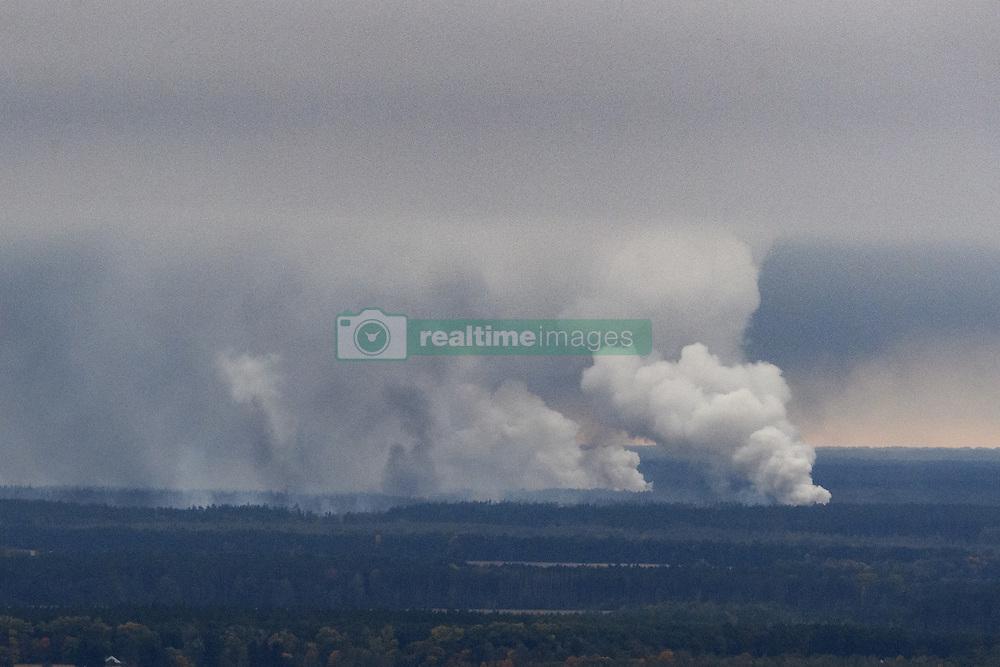 October 9, 2018 - Chernigov, Ukraine - Smoke rises after a fire and explosions hit the Ukrainian defence ministry ammunition depot in the eastern Chernigov region, Ukraine October 9, 2018. (Credit Image: © Maxym Marusenko/NurPhoto via ZUMA Press)