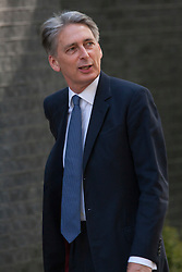 Downing Street, London July 15th 2014. New Foreign Secretary Phillip Hammond arrives at Downing Street as PM David Cameron reshuffles cabinet portfolios.