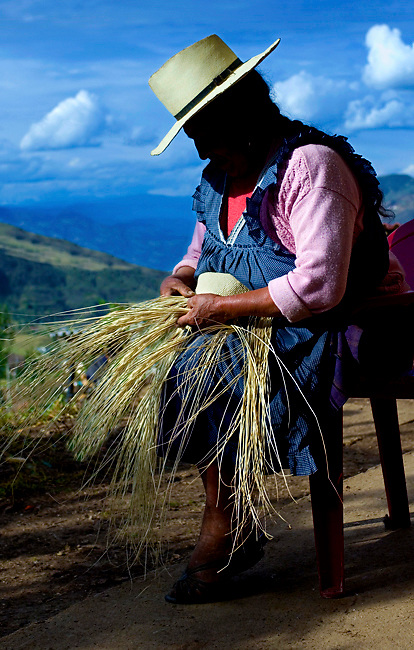 On a mountain farm outside of Cuenca a woman hand weaves a Panama hat from toquilla straw.  The Panama hat originated in Ecuador.