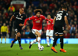 Marouane Fellaini of Manchester United goes past Steven N'Zonzi of Sevilla - Mandatory by-line: Robbie Stephenson/JMP - 13/03/2018 - FOOTBALL - Old Trafford - Manchester, England - Manchester United v Sevilla - UEFA Champions League Round of 16 2nd Leg