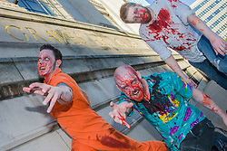 Slingshots Top Zombies Alex Noble, Noel Davies-Atack and Paul Byrne outside Graves Art Gallery Sheffield on Tuesday evening ahead of the game 2.8 Hours Later which reaches the city in August <br /> <br /> 30 June 2015<br />  Image © Paul David Drabble <br />  www.pauldaviddrabble.co.uk