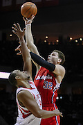 Jan 26, 2011; Houston, TX, USA; Los Angeles Clippers power forward Blake Griffin (32) shoots over Houston Rockets center Chuck Hayes (44) during the first quarter at the Toyota Center. Mandatory Credit: Thomas Campbell-US Presswire
