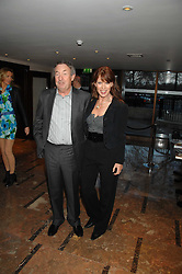 NICK & NETTE MASON at a party to celebrate the publication of Lisa B's book 'Lifestyle Essentials' held at the Cook Book Cafe, Intercontinental Hotel, Park Lane London on 10th April 2008.<br />