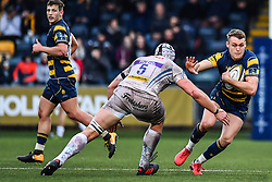 Jamie Shillcock of Worcester Warriors evades the tackle of Toby Salmon of Exeter Chiefs - Mandatory by-line: Craig Thomas/JMP - 27/01/2018 - RUGBY - Sixways Stadium - Worcester, England - Worcester Warriors v Exeter Chiefs - Anglo Welsh Cup
