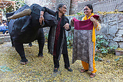Gurpreet Sidhu, founder of The People Tree boutique shares a laugh with one of her designers in the yard of their shop in Champa Gali, New Delhi, India. Champa Gali is the latest and most intimate of Delhis urban creative villages.