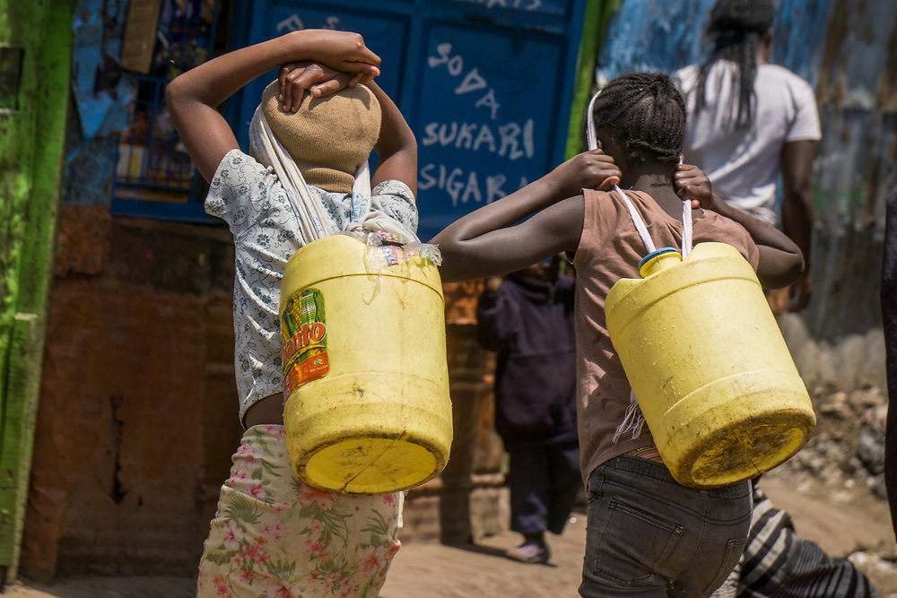 Young Girls Carrying Water by Sharon Achola