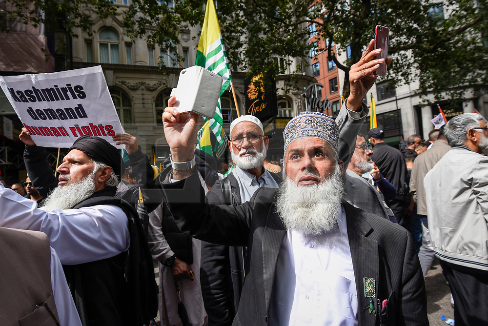 © Licensed to London News Pictures. 15/08/2019. LONDON, UK.  One of thousands of protesters, many waving Pakistani and Kashmiri flags, outside the Indian High Commission in Aldwych, on what they are calling Black Day, to stand in solidarity with the people of Kashmir.  Indian Prime Minister Narendra Modi delivered an Independence Day speech highlighting his decision to remove the special rights of Kashmir as an autonomous region.  Photo credit: Stephen Chung/LNP