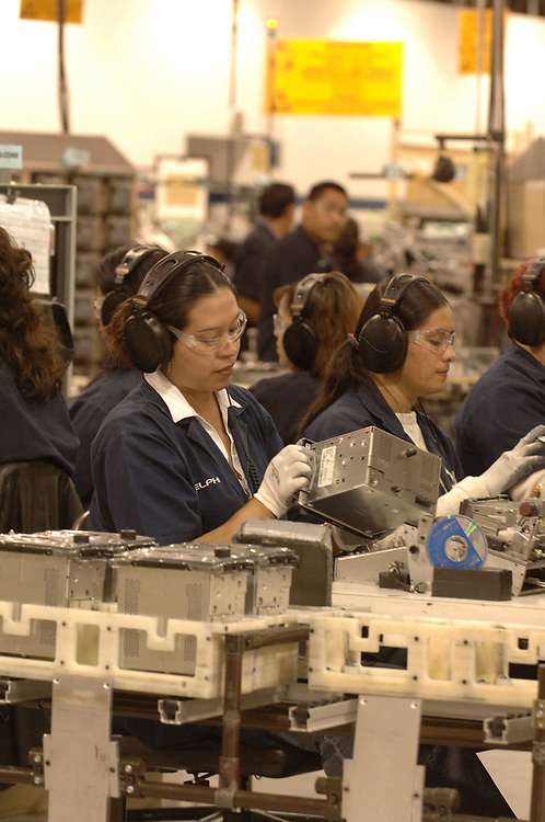 Matamoros, Mexico April, 2006: Car radios being manufactured at Delphi Delco Electronics de Mexico, a maquiladora plant across the U.S. border that makes parts for General Motors cars. Delphi has about 11,000 Mexican workers in seven factories near Matamoros. ©Bob Daemmrich