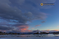 Ice skating at sunset on Flathead Lake in Somers, Montana, USA