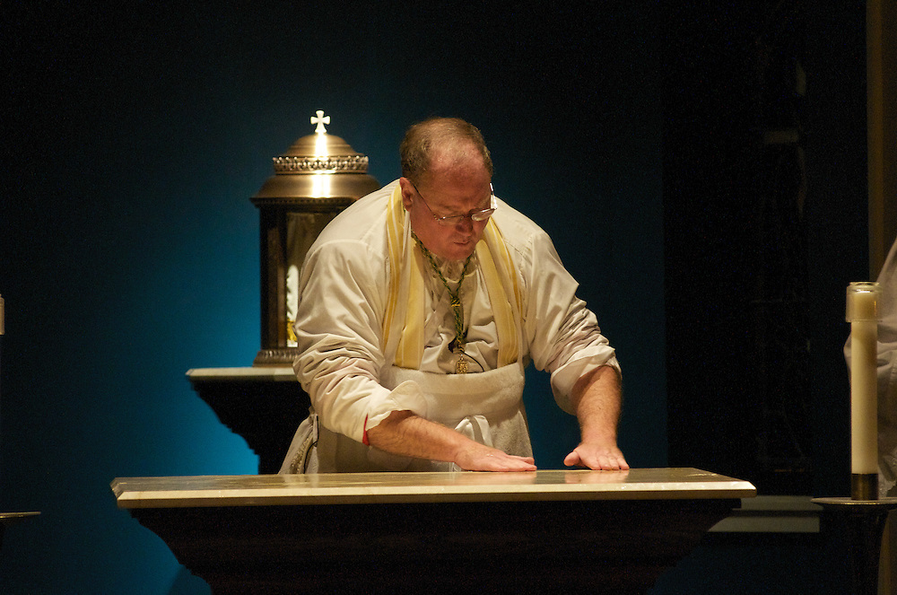 Archbishop Dolan anoints the Altar with Chrism at the dedication ceremony of the Three Holy Companions Chapel at Marquette University High School, Wednesday Nov. 5 2008.