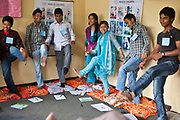 Nepalese teenagers stand on one foot during a life skills training session in Bisaneu Voice of Children centre in Kathmandu, Nepal.  The session is part of the rehabilitation program run by Voice of Children.  The not-for-profit organisation supports street children and those who are at risk of sexual abuse through educational and vocational training opportunities, health services and psychosocial counseling.
