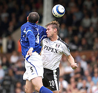 Photo: Daniel Hambury.<br /> Fulham v Everton. The Barclays Premiership.<br /> 27/08/2005.<br /> Fulham's goal scorer Brian McBride and Everton's Davie Weir battle for the ball.