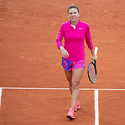 PARIS, FRANCE September 30. Simona Halep of Romania reacts during her match against Irina-Camelia Begu of Romania in the second round of the singles competition on Court Suzanne Lenglen during the French Open Tennis Tournament at Roland Garros on September 30th 2020 in Paris, France. (Photo by Tim Clayton/Corbis via Getty Images)