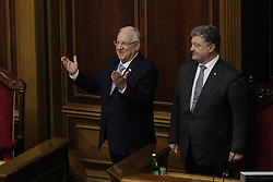 September 27, 2016 - Kiev, Ukraine - President of Israel Reuven Rivlin (L) and Ukrainian President Petro Poroshenko (R) attend a parliamentary hearings on ''The 75th anniversary of the Babyn Yar tragedy: History Lessons and Modernity'' at Ukrainian Parliament Verkhovna Rada, September 27, 2016.President of Israel Reuven Rivlin visits Ukraine for the first state visit. (Credit Image: © Sergii Kharchenko/NurPhoto via ZUMA Press)