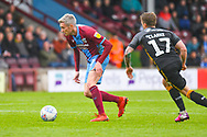 Matthew Lund of Scunthorpe United (7) in action during the EFL Sky Bet League 1 match between Scunthorpe United and Bradford City at Glanford Park, Scunthorpe, England on 27 April 2019.