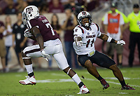 Texas A&M running back Keith Ford (7) makes South Carolina linebacker Eldridge Thompson (11) miss during the second quarter of an NCAA college football game Saturday, Sept. 30, 2017, in College Station, Texas. (AP Photo/Sam Craft)