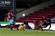 Scunthorpe United forward Hakeeb Adelakun (16) shoots at goal and Oldham Athletic goalkeeper Johnny Placide (19) makes a save during the EFL Sky Bet League 1 match between Scunthorpe United and Oldham Athletic at Glanford Park, Scunthorpe, England on 3 March 2018. Picture by Mick Atkins.