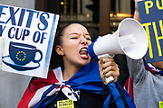 A young woman shouts protests through a megaphone during the People's Vote March on October 19th