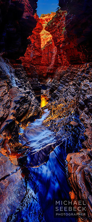 A vertical format panoramic image of a beautiful waterfall carved through aeons of rock strata, deep in a Pilbara gorge.<br /> <br /> Code: XAWP0002<br /> <br /> Limited Edition of 125 Prints