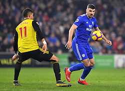 Cardiff City's Callum Paterson (right) and Watford's Adam Masina battle for the ball during the Premier League match at the Cardiff City Stadium.