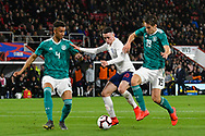 Phil Foden of England U21's is challenged by Felix Uduokhai of Germany U21's and Maximilian Mittelstadt of Germany U21's during the U21 International match between England and Germany at the Vitality Stadium, Bournemouth, England on 26 March 2019.