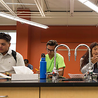 Justin Platero, left, John Barriga, center, and Jasmine Edsity, right, work on a few chemistry problems at the new lab stations at Rehoboth Christian High School in Rehoboth, New Mexico.