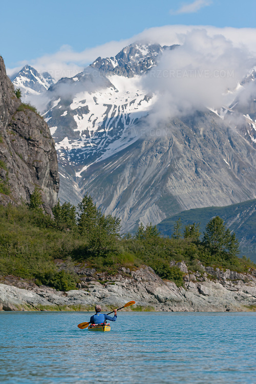 Sea kayak paddling in the West Arm of Alaska's Glacier Bay National Park and Preserve. Photo © Robert Zaleski / rzcreative.com<br /> —<br /> To license this image contact: robert@rzcreative.com