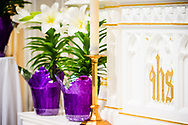 Easter lilies and the reredos on Monday, April 5, 2021, at Immanuel Lutheran Church, Washington, Mo. LCMS Communications/Erik M. Lunsford