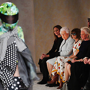 Britain's Queen Elizabeth (2nd L) sits with Chief Executive of the British Fashion Council Caroline Rush and editor-in-chief of Vogue Anna Wintour as models present creations by British designer Richard Quinn during London Fashion Week, in London, Britain, 20 February 2018. The presentation of the Women's Fall-Winter 2018/2019 collections runs from 15 to 20 February.