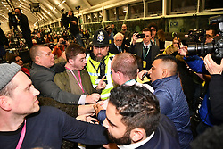 © Licensed to London News Pictures. 13/12/2019. London, UK. A fight breaks out as Shadow Chancellor JOHN MCDONNELL speaks at the General Election count for the constituency of Hayes and Harlington. A general election was called for December 12th following a deadlock in Parliament over the UK's decision to leave the EU. Photo credit: Ben Cawthra/LNP