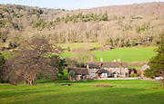 Exmoor farmhouse set amongst trees Brandish Street hamlet, Selworthy, Somerset, England