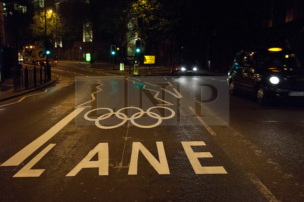 © Licensed to London News Pictures. 02/07/2012. London, UK. Traffic diverted on the Highway, London E1 overnight as Transport for London (TfL) paint white lines and Olympic ring markings for the Olympic Route Network. The new road markings will be used to create dedicated Olympic Games Lanes and ensure reliable and congestion free journeys for athletes and officials travelling during the 2012 London Olympic Games. Photo credit: Vickie Flores/LNP