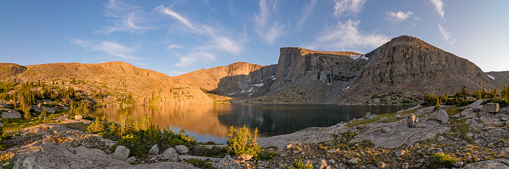 The Lost Twin Lakes are found at 10,300 feet  in the Cloud Peak Wilderness. A 6 mile hike from the West Tensleep Lake trailhead, it's the perfect spot for an overnight backpacking trip. The two lakes are in a glacial cirque surrounded by massive granite cliffs up to 2,000 feet high. This was a stitch of 6 pictures.