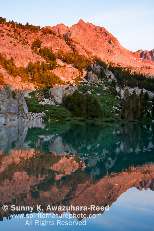 Sunrise glow on Sierra Mountains, reflect on Big Pine Lakes, Eastern Sierra, California