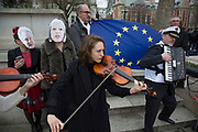 On the day that Article 50 was invoked to start the process of Brexit from the European Union, protesters gather in Westminster to show their displeasure that Britain will be leaving the EU, on March 29th 2017 in London, England, United Kingdom. A small group of musicians play sad laments to mark the occasion.