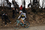 Belgium, March 31 2013: Kris Boeckmans, VACANSOLEIL-DCM, stretches while climbing the Oude-Kwaremont during the elite men's Ronde van Vlaandaren 2013 cycle race. Copyright 2013 Peter Horrell.