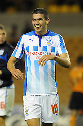 Huddersfield Town's Conor Coady smiles as his side go on to win 1 - 3 - Photo mandatory by-line: Dougie Allward/JMP - Mobile: 07966 386802 - 01/10/2014 - SPORT - Football - Wolverhampton - Molineux Stadium - Wolverhampton Wonderers v Huddersfield Town - Sky Bet Championship