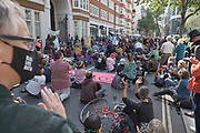 """Protesters clap at the chained protesters in front of the Home Office at the """"Climate Justice is Migrant Justice"""" protest, outside Home Office, Marsham Street in central London on Friday, Sept 4, 2020. (VXP Photo/ Gio Strondl)"""