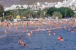 Puerto Rico; Gran Canaria; Canary Islands  beach scene with people swimming in sea,