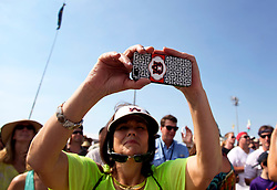02 May 2015. New Orleans, Louisiana.<br /> The New Orleans Jazz and Heritage Festival. <br /> iPhone in the crowd. <br /> Photo; Charlie Varley/varleypix.com