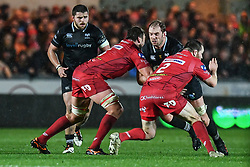 Ospreys' Alun Wyn Jones is tackled by Scarlets' David Bulbring and Ken Owens - Mandatory by-line: Craig Thomas/Replay images - 26/12/2017 - RUGBY - Parc y Scarlets - Llanelli, Wales - Scarlets v Ospreys - Guinness Pro 14
