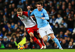 Aymeric Laporte of Manchester City takes on Sam Field of West Bromwich Albion - Mandatory by-line: Matt McNulty/JMP - 31/01/2018 - FOOTBALL - Etihad Stadium - Manchester, England - Manchester City v West Bromwich Albion - Premier League