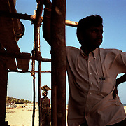 Workers rebuild a beach toilet in a village near Chennai, on the tsunami-hit southeastern coast of India..The December 26, 2004 tsunami killed thousands of people along this coast, smashing boats, roads and houses and tearing thousands of families apart. .Picture taken February 2005 in Nagapptinam, Tamil Nadu, India, by Justin Jin.