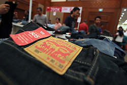June 18, 2017 - Jakarta, DKI Jakarta, Indonesia - Toward the Idul Fitri holidays, Jakarta people crowded Cendrawasih Room Jakarta Convention Center (JCC) Senayan at Levi's Warehouse Sale. With offer price up to 70% and additional discounts up to 15%, various age groups looking to sort Levis products for clothing Which feels fit to wear at the holiday. (Credit Image: © Kuncoro Widyo Rumpoko/Pacific Press via ZUMA Wire)