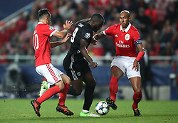 Manchester United's Romelu Lukaku (centre) in action with Benfica's Oliveira Jonas (left) and Anderson Luisao