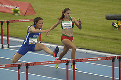 October 12, 2018 - Buenos Aires, Buenos Aires, Argentina - TING-WEI LIN of Chinese Taipei jumps the hurdle to win followed by MARIA FERNANDA PATRON NOGUERA of Mexico during the Women's 100m Hurdles (76.2cm) Stage 1 - Heat 3 on Day 5 of the Buenos Aires 2018 Youth Olympic Games at the Olympic Park. (Credit Image: © Patricio Murphy/ZUMA Wire)